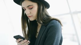Answering messanger texting with cell phone. Video footage. Hipster young girl stock video footage
