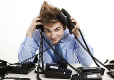 Answering multiple calls at the same time Royalty Free Stock Photo