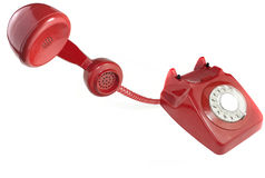 Answering an old fashioned red telephone Stock Photography