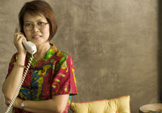 Answering the telephone Stock Image
