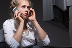 Answering urgent telephone Stock Images