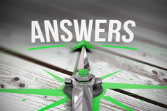 Answers against digitally generated grey wooden planks Stock Photo