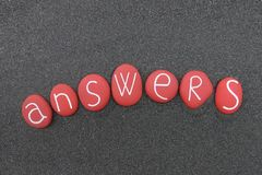 Answers, conceptual text with red colored stones over black volcanic sand Royalty Free Illustration