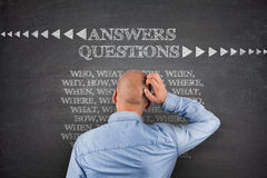 Answers questions on blackboard Stock Image