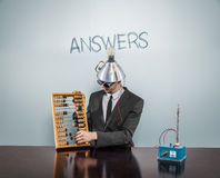 Answers text on blackboard with businessman Royalty Free Stock Image