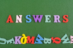 ANSWERS word on green background composed from colorful abc alphabet block wooden letters, copy space for ad text. Learning english concept royalty free stock image