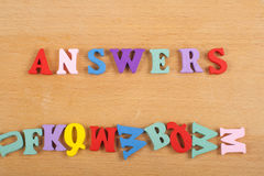 ANSWERS word on wooden background composed from colorful abc alphabet block wooden letters, copy space for ad text royalty free stock image