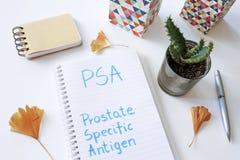 Antígeno Próstata-específico da PSA escrito no caderno imagens de stock royalty free