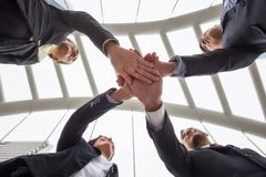 Business team gather hands in city. Ant eye view of business team gather hands to encourage and cheer up in modern city. working team to achieve target goal and royalty free stock images