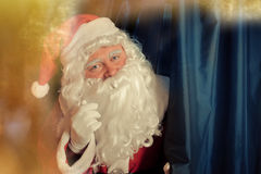 Anta Claus staying near curtain Royalty Free Stock Images