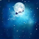 Anta et son traîneau volant au-dessus du paysage neigeux images libres de droits