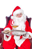 Anta with large drink and cookies Royalty Free Stock Photo