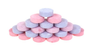 Antacid Tabs Stacked. A stack of berry flavored antiacid calcium supplements Royalty Free Stock Image