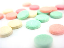 Antacids. Multi-colored chewable antacid tablets spilled from bottle Royalty Free Stock Photography