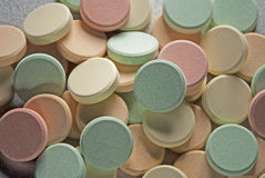 Antacids. Antacid pills of various colors on top of each other Royalty Free Stock Photography