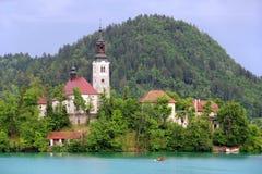 Antagande av Mary Pilgrimage Church på Bled sjön Arkivfoton