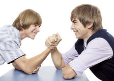 Antagonism. Two youth are doing arm wrestling Royalty Free Stock Photos