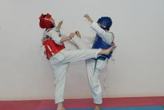 Antagonism training-Taekwondo training hall. In the Taekwondo training hall, the children are participating in various Taekwondo training activities to Royalty Free Stock Images