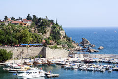 Antalya harbor. Famous old harbor in Antalya with boats, ships and yachts anchored in it Stock Photography