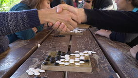 Antalya - Kas, TURKEY. DECEMBER 2016: Chinese go, weiqi game workshop with students. Outdoor activity.Chinese go, weiqi game workshop with students. Hand shake Royalty Free Stock Image