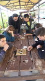 Antalya - Kas, TURKEY. DECEMBER 2016: Chinese go, weiqi game workshop with students. Outdoor activity.Chinese go, weiqi game workshop with students Royalty Free Stock Image