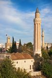 Antalya mosque. Fluted minaret(Yivli minare) mosque of Mehmet Pasha and tower clock are local town landmarks in Antalya, Turkey Stock Photography