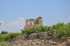Antalya Perge ancient Greek city, a building just stayed in silhouette. Royalty Free Stock Image