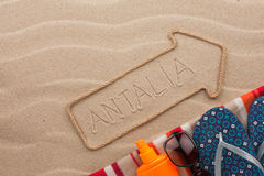 Antalya  pointer and beach accessories lying on the sand Royalty Free Stock Images
