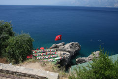 Beautiful Turkish coastline. Private beach in Antalya, Turkey with crystal clear turquoise water Royalty Free Stock Images