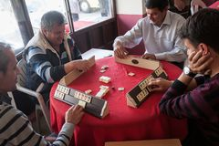 Local turkish men playing very table game Okey, or rummikub, in. Antalya,Turkey -aprill 22, 2012: Local turkish men playing very popular local table game Okey Royalty Free Stock Photo