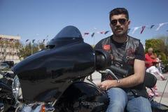 Happy driver riding Harley Davidson. Antalya, Turkey - May 21, 2017: Antalya, Harley Davidson motor convoys on the road. Festival name is Antalya Rally, Demo Royalty Free Stock Photography