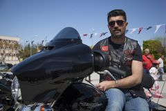 Happy driver riding Harley Davidson. Antalya, Turkey - May 21, 2017: Antalya, Harley Davidson motor convoys on the road. Festival name is Antalya Rally, Demo Stock Photo