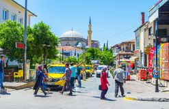Taxi in Antalya. ANTALYA, TURKEY - MAY 13, 2017: The taxi station in Mescit street, next to the Ataturk Boulevard with the dome and minaret of Imaret Mosque on royalty free stock photography