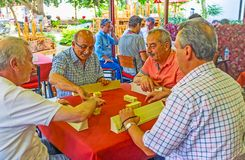 Okey players in Antalya tea house. ANTALYA, TURKEY - MAY 12, 2017: The tea house with many senior clients, playing popular local game, named Okey Rummikub, on Royalty Free Stock Images