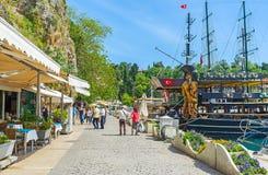 Promenade of Antalya old marina. ANTALYA, TURKEY - MAY 12, 2017: The tourists walk along the promenade with pleasue boats, galleons, cafes and bars of old marina Stock Photography