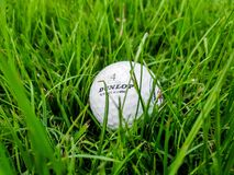 Antalya, Turkey, November 2019: A white Golf ball with logo Dunlop lies in the grass on the Golf course