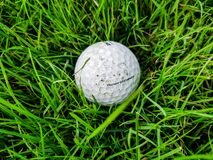 Antalya, Turkey, November 2019: A white Golf ball with logo lies in the grass on the Golf course