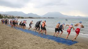Alanya Triathlon, Antalya, Turkey. ANTALYA, TURKEY - SEPTEMBER 30, 2017: Athletes competing in swimming component of Alanya Triathlon Royalty Free Stock Photos