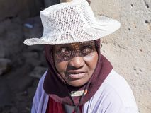 Old woman with white sun hat royalty free stock image