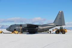 Antarctic  air travel. Loading a Royal New Zealand Air Force C130 Hercules transport aircraft at Pegasus runway, near McMurdo, Antarctica. Aircraft use a blue Royalty Free Stock Images