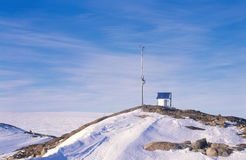 Antarctic Automatic Weather Station. An Automatic Weather Station located at Haupt Nunatak at the edge of the Vanderford Glacier, Antarctica Royalty Free Stock Images