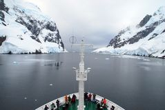 Antarctic Expedition Vessel. Antarctic expedition cruise ship navigating The Lemaire Passage, a very narrow passage the Antarctic Peninsula stock photography