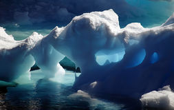 Antarctic ice caves. Shimmering blue