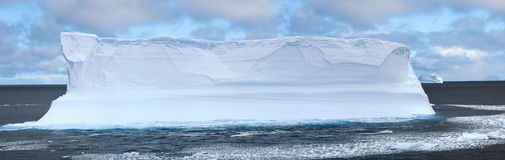 Antarctic ice island. With penguins  in atlantic ocean Royalty Free Stock Photos