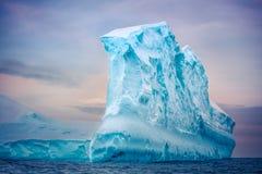 Antarctic iceberg floating in ocean Royalty Free Stock Image