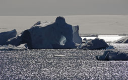 Antarctic iceberg with hole Royalty Free Stock Photography