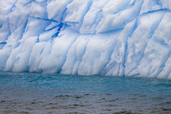 Antarctic Iceberg Pattern. A close up of a fissured and eroded iceberg showing the beatiful blue tones within. Taken in Antarctica Stock Images