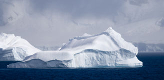 Antarctic iceberg in sunlight Stock Photos