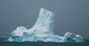 Antarctic iceberg tower. Iceberg off the Antarctic peninsula in gloomy weather royalty free stock photography