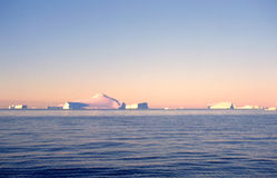 Antarctic Icebergs. Nine-tenths of an iceberg is underwater.  Thus these are just the tip of the iceberg Stock Photos